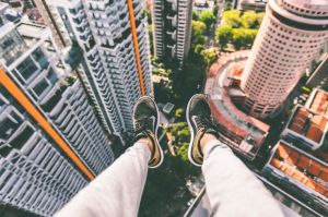 Legs dangling off a high building