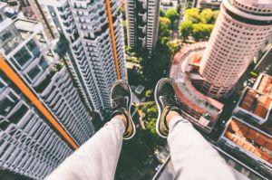 Legs dangling off a high building